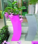 Pink and silver/Grey Curvy Planters in-situ